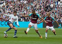 Football - 2017 / 2018 Premier League - West Ham United vs Tottenham Hotspur<br /> <br /> Dele Alli (Tottenham FC) checks back and wrong foots Winston Reid (West Ham United) and Pablo Zabaleta (West Ham United) at the London Stadium<br /> <br /> COLORSPORT/DANIEL BEARHAM