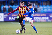 Macclesfield Town midfielder Connor Kirby challenge Bradford City defender Adam Henley during the EFL Sky Bet League 2 match between Macclesfield Town and Bradford City at Moss Rose, Macclesfield, United Kingdom on 30 November 2019.