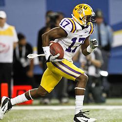Dec 3, 2011; Atlanta, GA, USA; LSU Tigers cornerback Morris Claiborne (17) runs back a kickoff against the Georgia Bulldogs during the first half of the 2011 SEC championship game at the Georgia Dome.  Mandatory Credit: Derick E. Hingle-US PRESSWIRE
