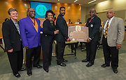 Houston ISD Board of Trustees member Paula Harris oversees the donation of a bronze plaque dedicated to Jones High School graduate and Pro Football Hall of Fame defensive back Darrell Green to the Prairie View Interscholastic League during the Board of Trustees meeting, February 12, 2015.