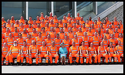 Image licensed to i-Images Picture Agency. 17/07/2014. Reading, United Kingdom. The Queen poses with construction workers for a group photograph  after opening Reading Railway Station in Berkshire, United Kingdom, to mark a £895 million (pounds sterling)  re-development of the station.  Picture by Stephen Lock / i-Images