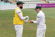 Hand sanitising Aaron Lilley dispenses the soap to Harry Dearden during the Bob Willis Trophy match between Lancashire County Cricket Club and Leicestershire County Cricket Club at Blackfinch New Road, Worcester, United Kingdom on 4 August 2020.