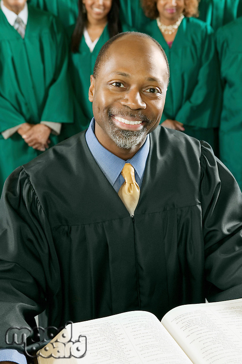 Smiling Preacher with Bible in church portrait