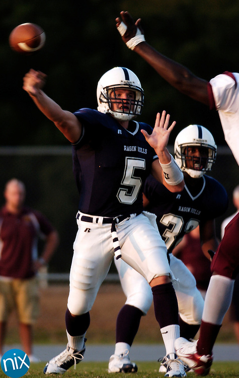 Hickory Ridge's Brent Lilly passes against Jay M. Robinson in Harrisburg Friday, August 29, 2008. (photo by James Nix)
