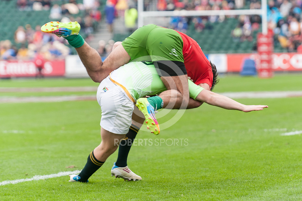 Portugal's Diogo Miranda takes drastic action to try and slow down South Africa's Mark Richards. Action from the IRB Emirates Airline Glasgow 7s at Scotstoun in Glasgow. 3 May 2014. (c) Paul J Roberts / Sportpix.org.uk