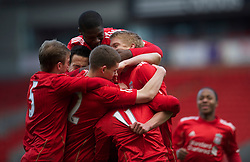 LIVERPOOL, ENGLAND - Saturday, January 8, 2011: Liverpool's Kristjan Emilsson is mobbed by team-mates as he celebrates scoring the equalising goal against Crystal Palace during the FA Youth Cup 4th Round match at Anfield. (Pic by: David Rawcliffe/Propaganda)