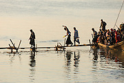 Commuter boat full of people, unloading on the Chindwin River, Monywa