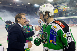Hannu Järvenpää, head coach of HDD Tilia Olimpija, celebrates with Sergei Smirnov (HDD Tilia Olimpija, #98) during ice-hockey match between HDD Tilia Olimpija and SAPA Fehervar AV19 at sixth match in Quarterfinal  of EBEL league, on March 1, 2012 at Hala Tivoli, Ljubljana, Slovenia. HDD Tilia Olimpija won 4:3. (Photo By Matic Klansek Velej / Sportida)