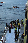 Atmosphere at The US Airways A320 crashsite which crash landed into the NY Hudson River sparking major rescue operation. Plane came within 900ft of George Washington Bridge. It is believed all passengers were saved as a result of Pilot's skill.