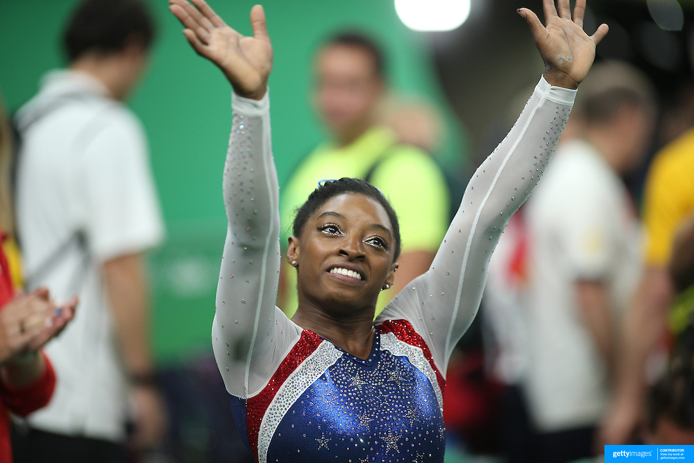 Gymnastics - Olympics: Day 6  Simone Biles of the United States reacts to the crowd after winning the gold medal during the Artistic Gymnastics Women's Individual All-Around Final at the Rio Olympic Arena on August 11, 2016 in Rio de Janeiro, Brazil. (Photo by Tim Clayton/Corbis via Getty Images)