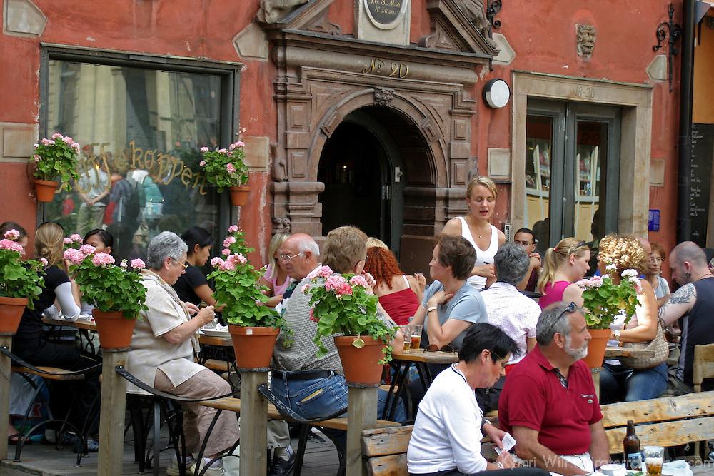 Europe, Sweden, Stockholm. Outdoor cafe of Gamla Stan.