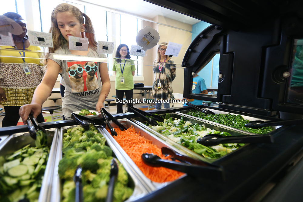 Ella Michael Gable, 8, a second grader at Joyner Elementary School, makes a salad at the school's new salad bar during lunch on Tuesday. The Joyner salad bar (funded by a grant) is part of a larger effort by the Tupelo Public School District to make healty Habits part of students everyday lives.