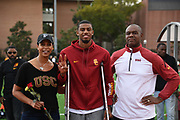 Mar 24, 2018; Los Angeles, CA, USA; Randall Cunningham Jr. (center) poses with mother Felicity Cunningham (left) and father Randall Cunningham during the Power 5 Trailblazer challenge at Cromwell Field.