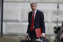 © Licensed to London News Pictures. 08/01/2018. London, UK. Philip Hammond  arrives at the back of Downing Street ahead of an expected cabinet reshuffle. A number of senior moves are expected ahead of a new phase in Brexit negotiations and following the recent resignation of First Secretary Damian Green. Photo credit: Peter Macdiarmid/LNP