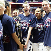 Katie Lou Samuelson (center), with team mates at the trophy presentation during the UConn Huskies Vs USF Bulls 2016 American Athletic Conference Championships Final. Mohegan Sun Arena, Uncasville, Connecticut, USA. 7th March 2016. Photo Tim Clayton