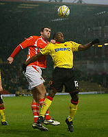 Photo: Richard Lane/Richard Lane Photography. Watford v Blackpool. Coca Cola Championship. 01/11/2008. Ben Burgess (L) and Lloyd Doyley (R) in a strong aerial challnge
