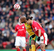 London - Saturday, January 12th, 2008: Dennis Souza of Barnsley and Dion Dublin of Norwich City during the Coca Cola Champrionship match at Oakwell, Barnsley. (Pic by Paul Hollands/Focus Images)