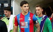 Ryan Iniss leads Palace out in the new home strip, the first time being worn this season before the Pre-Season Friendly match between Tooting & Mitcham and Crystal Palace at Imperial Fields, Tooting, United Kingdom on 24 July 2015. Photo by Michael Hulf.