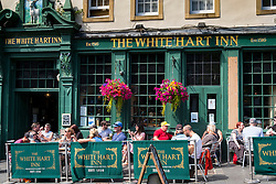 Busy White Hart Inn in Grassmarket district of Edinburgh , Scotland, United Kingdom