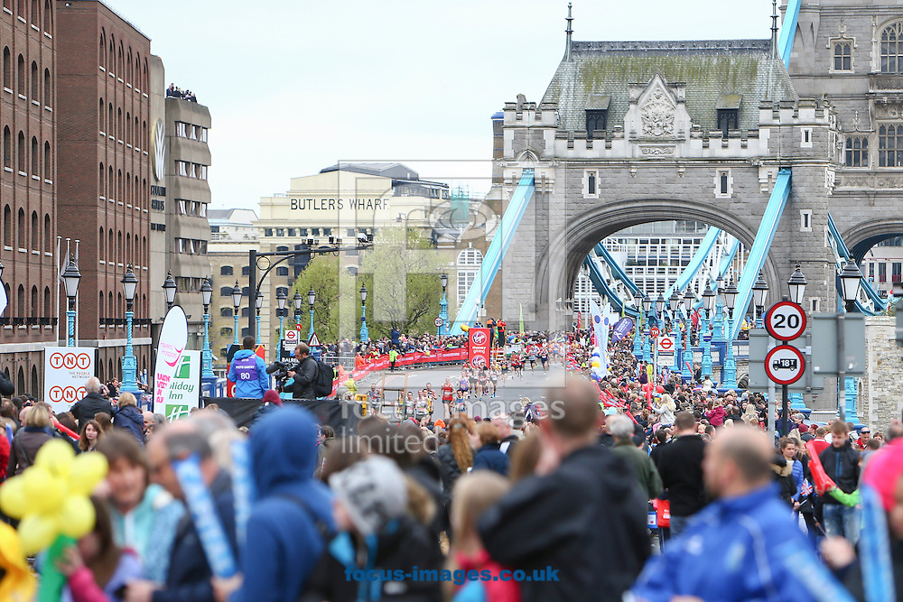 The early runners are pictured crossing Tower Bridge as the crowd cheers them on during the Virgin London Marathon. <br /> Picture by Ryan Dinham/Focus Images Ltd +44 7900 436859<br /> 26/04/2015