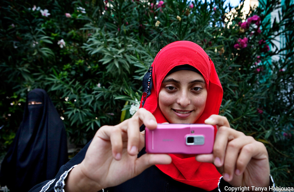 An English literature student at the Islamic University in Gaza takes a break with fellow students. She is eager to apply her English skills and says that her dream is to travel the world. The siege on Gaza makes travel near impossible for the vast majority of Gazans.