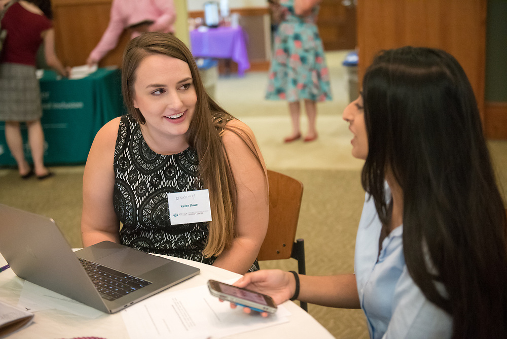 Kailee Slusser talks with her mentee Kisha Ravi during the Women's Mentoring Meet and Greet event on Sept. 4, 2018 in Walter Rotunda. Photo by Hannah Ruhoff