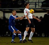 Photo: Daniel Hambury.<br />Luton Town v Cardiff City. Coca Cola Championship. 14/02/2006.<br />Luton's Steve Howard and Cardiff's Darren Purse battle.
