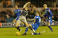 Photo: Alan Crowhurst.<br />Millwall v Reading. Coca Cola Championship. 17/12/2005. Millwall's Tony Craig (R) brings down Kevin Doyle for a penalty and earned himself a red card.