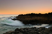 Pacific Ocean waves pound the rocky shoreline along the Wild Pacific Trail near Ucluelet, Vancouver Island.