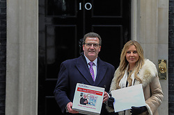 "© Licensed to London News Pictures. 26/01/2017. London, UK. John Nichol, an RAF veteran who was shot down during the Gulf War, accompanies Carol Vordeman, TV personality, as they hand in a petition with 237,800 signatures at number 10 Downing Street.  The petition calls for George ""Johnny"" Johnson, aged 95, who took part in the WW2 Dambusters operation, to receive a knighthood.  Photo credit : Stephen Chung/LNP"