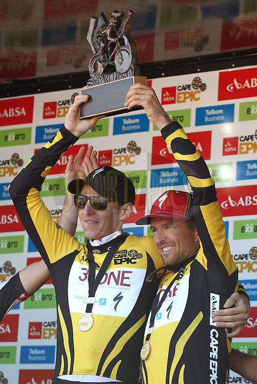 Absa Cape Epic 2013 winner Jaroslav Kulhavy and Christoph Sauser of Burry Stander-SONGO celebrate with the Absa Cape Epic Trophy during the final stage (stage 7) of the 2013 Absa Cape Epic Mountain Bike stage race from Stellenbosch to Lourensford Wine Estate in Somerset West, South Africa on the 24 March 2013..Photo by Shaun Roy/Cape Epic/SPORTZPICS
