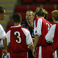 St Johnstone v Brechin....26.08.03<br />Kenny Clark i surrounded by Brechin players aftert awrading St Johnstone a penalty, he later changed his mind<br />Picture by Graeme Hart.<br />Copyright Perthshire Picture Agency<br />Tel: 01738 623350  Mobile: 07990 594431