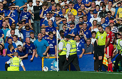 LIVERPOOL, ENGLAND - Saturday, October 1, 2011: Liverpool's Craig Bellamy has bottles and abuse thrown at him from the stands by Everton supporters during the Premiership match at Goodison Park. (Pic by David Rawcliffe/Propaganda)