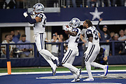 Dallas Cowboys outside linebacker Damien Wilson (57) jumps in the air as Dallas Cowboys free safety Kavon Frazier (35) runs into the end zone in celebration with Cowboys cornerback Jourdan Lewis (27) after Lewis intercepts a late fourth quarter pass and runs it back 7 yards to the New Orleans Saints 16 yard line on the game winning turnover as the time clocks winds down during the NFL week 13 regular season football game against the New Orleans Saints on Thursday, Nov. 29, 2018 in Arlington, Tex. The Cowboys won the game 13-10. (©Paul Anthony Spinelli)
