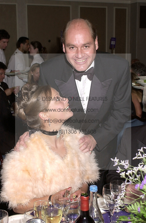 The HON.SIMON HOWARD and the HON.REBECCA SIEFF, at the Game Conservancy Ball held at the Grosvenor House Hotel, London on 15th may 2001.