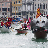 "VENICE, ITALY - FEBRUARY 16:  The ""Pantegana""  (Big Rat) sails on the Gran Canal for the traditional regatta which officially opens the Carnival  on February 16, 2014 in Venice, Italy. The 2014 Carnival of Venice will run from February 15 to March 4 and includes a program of gala dinners, parades, dances, masked balls and music events.  (Photo by Marco Secchi/Getty Images)"