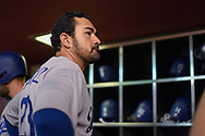 PHOENIX, AZ - AUGUST 31:  Adrian Gonzalez #23 of the Los Angeles Dodgers prepares in the dugout for the MLB game against the Arizona Diamondbacks at Chase Field on August 31, 2017 in Phoenix, Arizona.  (Photo by Jennifer Stewart/Getty Images)
