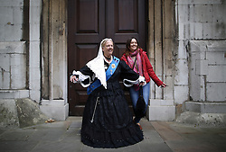 © Licensed to London News Pictures. 27/09/2015. London, UK. A woman dresses as Queen Victoria jokes with a Russian tourist before taking part in a Harvest Festival celebration. Photo credit: Peter Macdiarmid/LNP