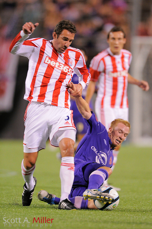 Stoke City defender Danny Higginbotham (3) and Orlando City Lions forward Jamie Watson (77) go for a ball during the Potters 1-0 win at the Florida Citrus Bowl on July 28, 2012 in Orlando, Florida. ..©2012 Scott A. Miller.