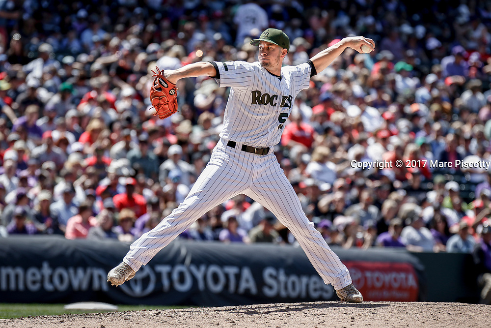SHOT 5/28/17 1:51:27 PM - Colorado Rockies reliever Chris Rusin #52 pitches against the St. Louis Cardinals  during their regular season MLB game at Coors Field in Denver, Co. The Rockies won the game 8-4. (Photo by Marc Piscotty / © 2017)