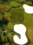 Aerial photograph straigh down on early morning scene of golfers on golf green surrounded by sand traps.  Bonnaventure Country Club, Weston, Fl