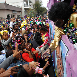 February 21, 2012; New Orleans, LA, USA; Scenes from the Krewe of Zulu parade as it rolled along the uptown New Orleans St. Charles Avenue parade route throwing beads, painted coconuts and various trinkets on Mardi Gras day. Mardi Gras is an annual celebration that ends at midnight with the start of the Catholic Lenten season which begins with Ash Wednesday and ends with Easter. Photo by: Derick E. Hingle