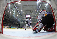 Kloten Flyers forward Victor Stancescu (R only head visible) scores the winning goal to the score of 3-2 against ZSC Lions goaltender Ari Sulander (2nd R) and Alexey Krutov (C) during overtime in the ice hockey game five of the Swiss National League A Playoff Quarterfinal between Kloten Flyers and ZSC Lions held at the Kolping Arena in Kloten, Switzerland, Tuesday, March 8, 2011. (Photo by Patrick B. Kraemer / MAGICPBK)