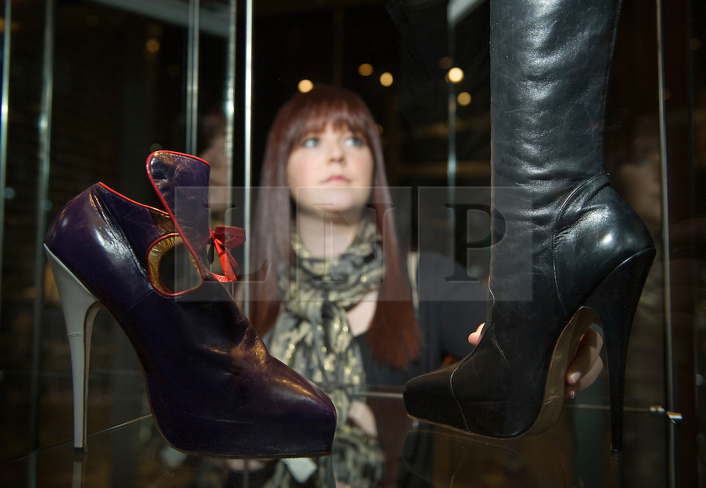 © licensed to London News Pictures. The Bowes Museum, County Durham, UK  09/06/11...Abigail Potter form Newcastle University adjusts part of the Vivienne Westwoord Display at Bowes Museum...An exhibition celebrating the ingenuity and creativity of the British fashion designer Dame Vivienne Westwood, focusing on her shoe designs, takes place at The Bowes Museum in County Durham...Vivienne Westwood's shoes are celebrated the world over for leading the way in design, creativity and style and have become famous British icons in their own right...Please see special instructions for usage rates. Photo credit should read Ian Forsyth/LNP