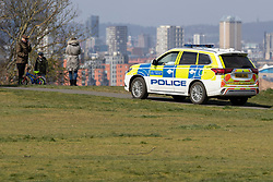 © Licensed to London News Pictures. 29/03/2020. London, UK. A Police car patrols Greenwich Park . The Government has announced a lockdown to slow the spread of Coronavirus and reduce pressure on the NHS. Photo credit: George Cracknell Wright/LNP
