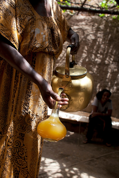 Honey wine or Tej poured from a kettle in Abiy Addi, Northern Ethiopia.
