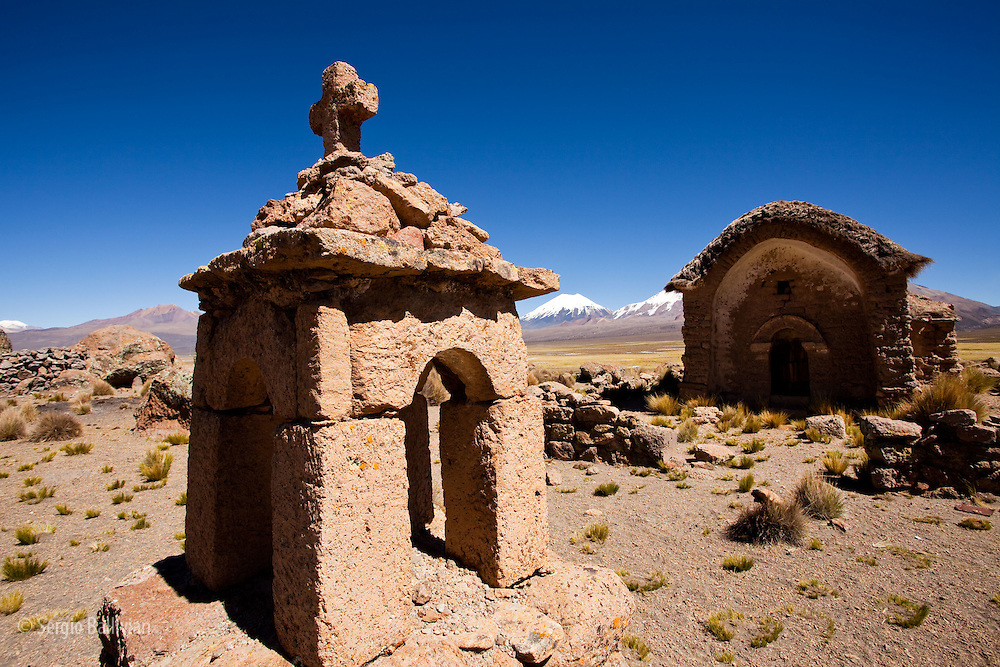 An old colonial-era church located in the high-altitude Sajama National Park in Bolivia is dwarfed by the Payachatas - the twin volcanoes - one in Chile and the other in Bolivia that straddle the border region.