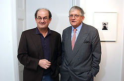 Left to right, writer SALMAN RUSHDIE and artist DAVID HOCKNEY at a private view of an exhibition of photographs by the late Robert Mapplethorpe curated by artist David Hockney at the Alison Jacques Gallery, 4 Clifford Street, London W1 on 13th January 2005.<br /><br />NON EXCLUSIVE - WORLD RIGHTS