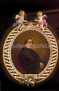 Reverse side of a Gioacchino Rossini's mirror with a portrait of himself / Parte posteriore di uno specchio appartenuto a Gioacchino Rossini con un suo ritratto - © Marcello Mencarini