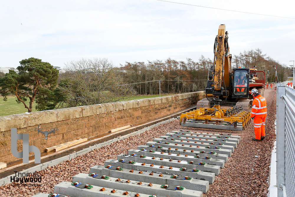 sleepers being laid on the red bridge viaduct over the River Tweed just short of the terminus at Tweedbank on 4th Feb 2015